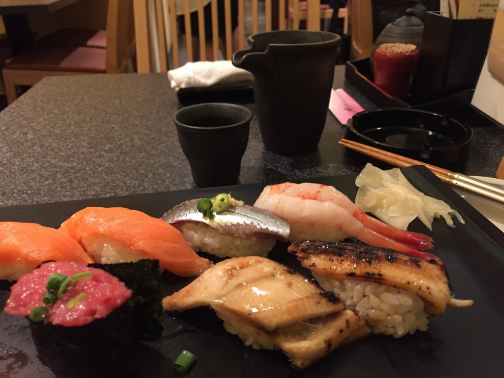 Sorry, there's a piece missing from the lower left. I ate it before I remembered to take the picture. It's sushi, plus an embedded Zen lesson in impermanence.