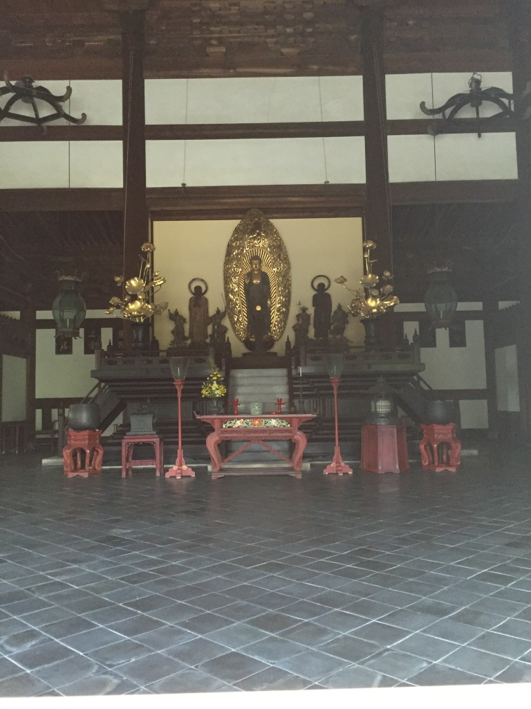 I thought I should include at least one picture of a Buddhist altar. Here you go.