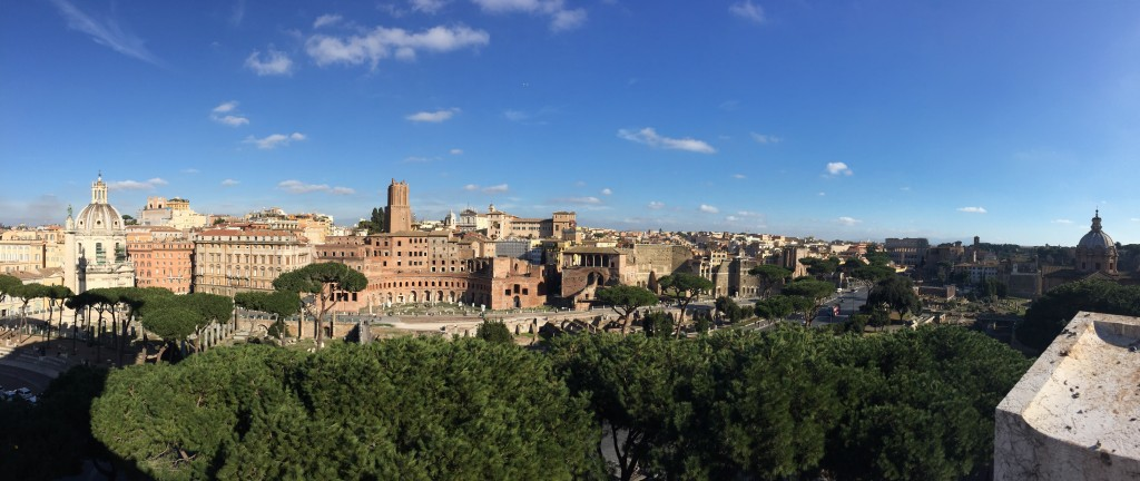 Looking east from the Piazza Venezia. The Colosseum is towards the right, with some scaffolding on it.