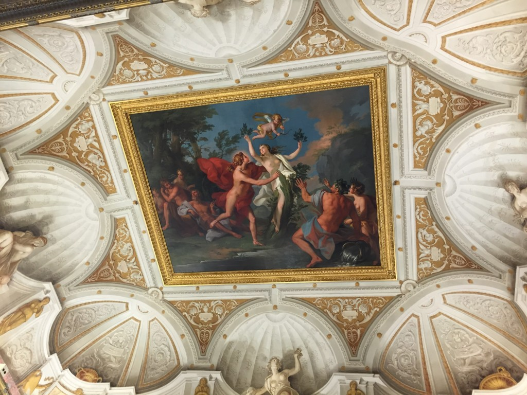 "The ceiling of the Apollo and Daphne room, featuring the cheeriest version of the myth that I may have ever seen, with Daphne becoming a tree with blithe abandon. ""Hey, ho, I think I'll be sprouting now."""