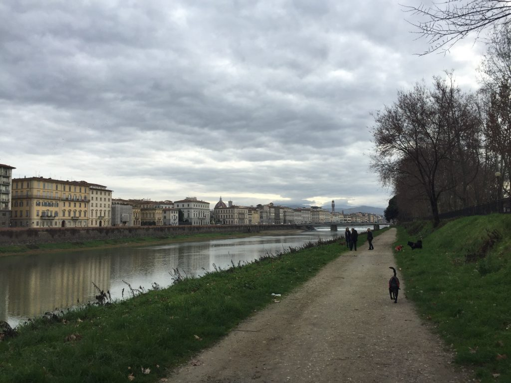 Heading south, along the path down near river level. The city center is on the other side, and you can see the dome of Santa Maria del Fiore in the distance and the tower of the Palazzo Vecchio (the town hall of Florence).