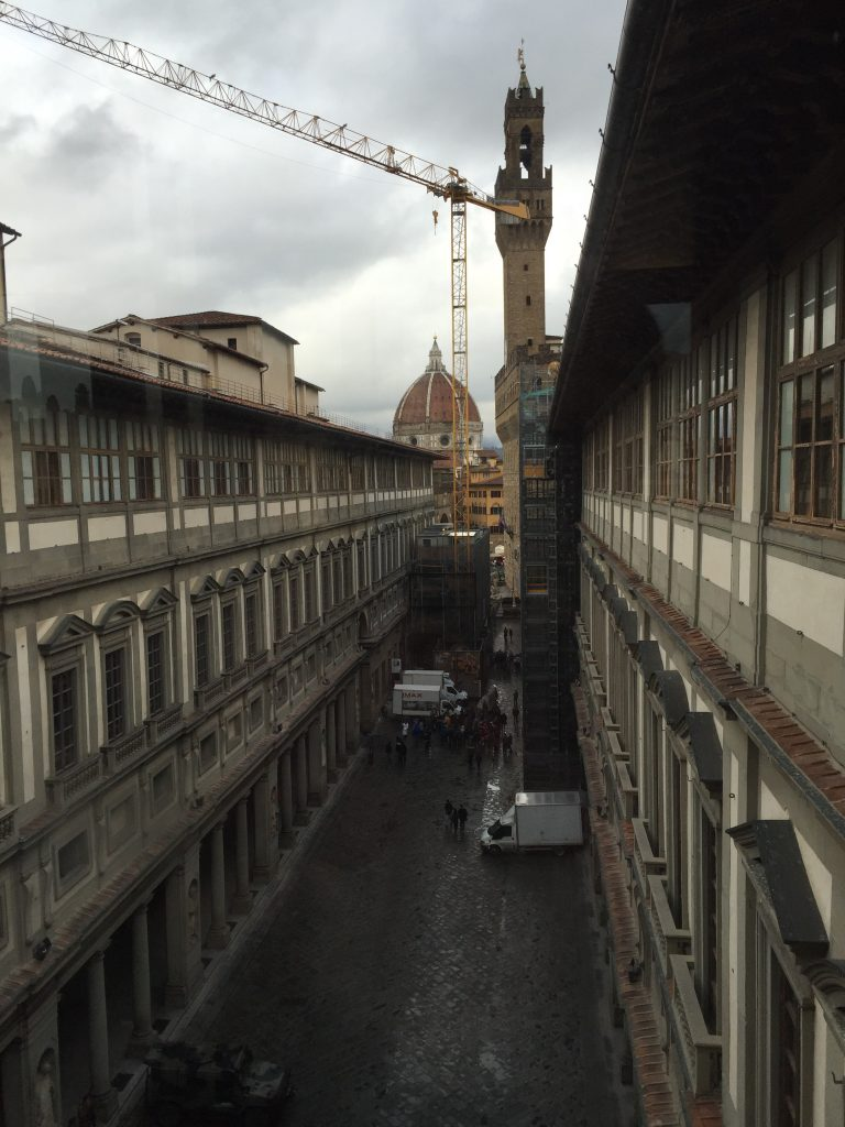 A view of the Uffizi Gallery, that the Museum wraps around, looking east toward the Lucy Fainting Plaza, from the short hallway on the western end.