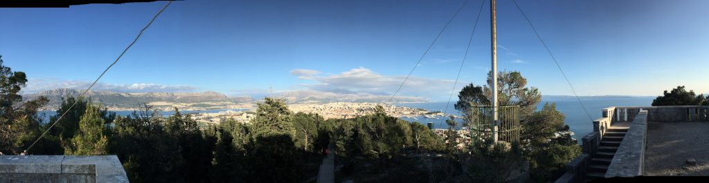 There's a small plaza, and a Croatian flag, at the top of Marjan, and here's a panorama looking east down the peninsula, including the bay to the north and the Adriatic to the south (with one of many islands visible in it).