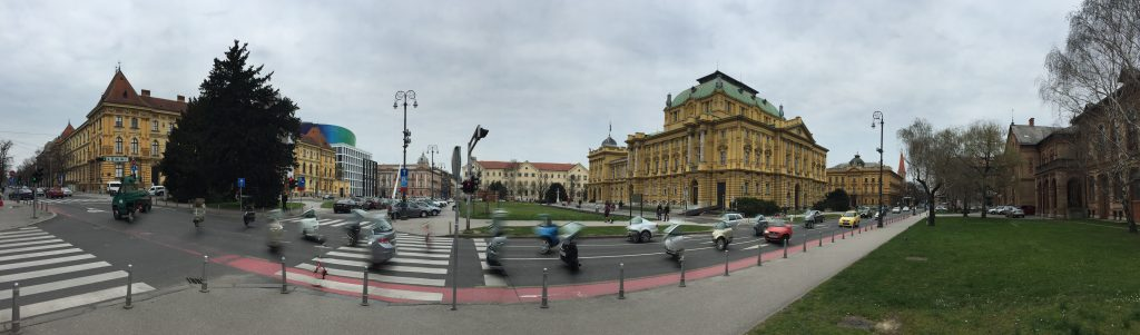 A panorama of Marshall Tito Square, which has several museums around it. You'll also notice the partial cars driving by; Croatian economy is struggling, and it takes some people a while to save up enough to buy a whole car. They make do.