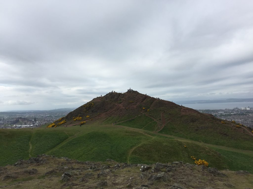 Holyrood Park has several hills including the highest point, known as Arthur's Seat, which was my primary destination. I was not alone. If you can make out the little prickly bits on the top of that hill, looking at a distance like pigeon guard spikes, those are tourists. Noisy ones. Lots of them. I waited out the crowd on this more southerly hill, and was rewarded with some nice views.