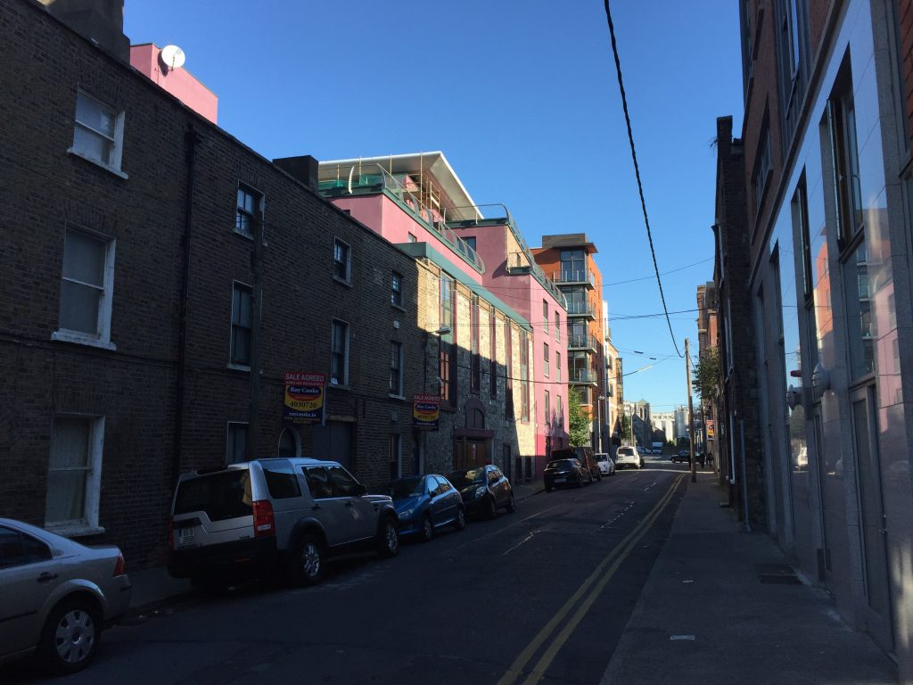This is a pretty typical Dublin street, as far as I can tell. The city center is more picturesque, but the morning light is hitting these buildings nicely.